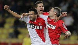 Monaco's Jeremy Toulalan of France, right  reacts with his teammates Mounir Obbadi of France, left, and Joao Moutinho of Portugal after scoring the second goal during the French League One soccer match against Reims, in Monaco stadium, Friday, Feb. 21 , 2014. (AP Photo/Lionel Cironneau)