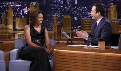 In this image provided by NBC Universal First Lady Michelle Obama is seen during an interview with host Jimmy Fallon on Thursday Feb. 20, 2014. (AP Photo/NBC, Lloyd Bishop)