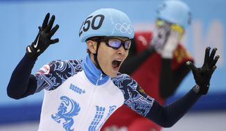 Victor An of Russia reacts as he crosses the finish line first in the men's 500m short track speedskating final at the Iceberg Skating Palace during the 2014 Winter Olympics, Friday, Feb. 21, 2014, in Sochi, Russia. (AP Photo/Bernat Armangue)