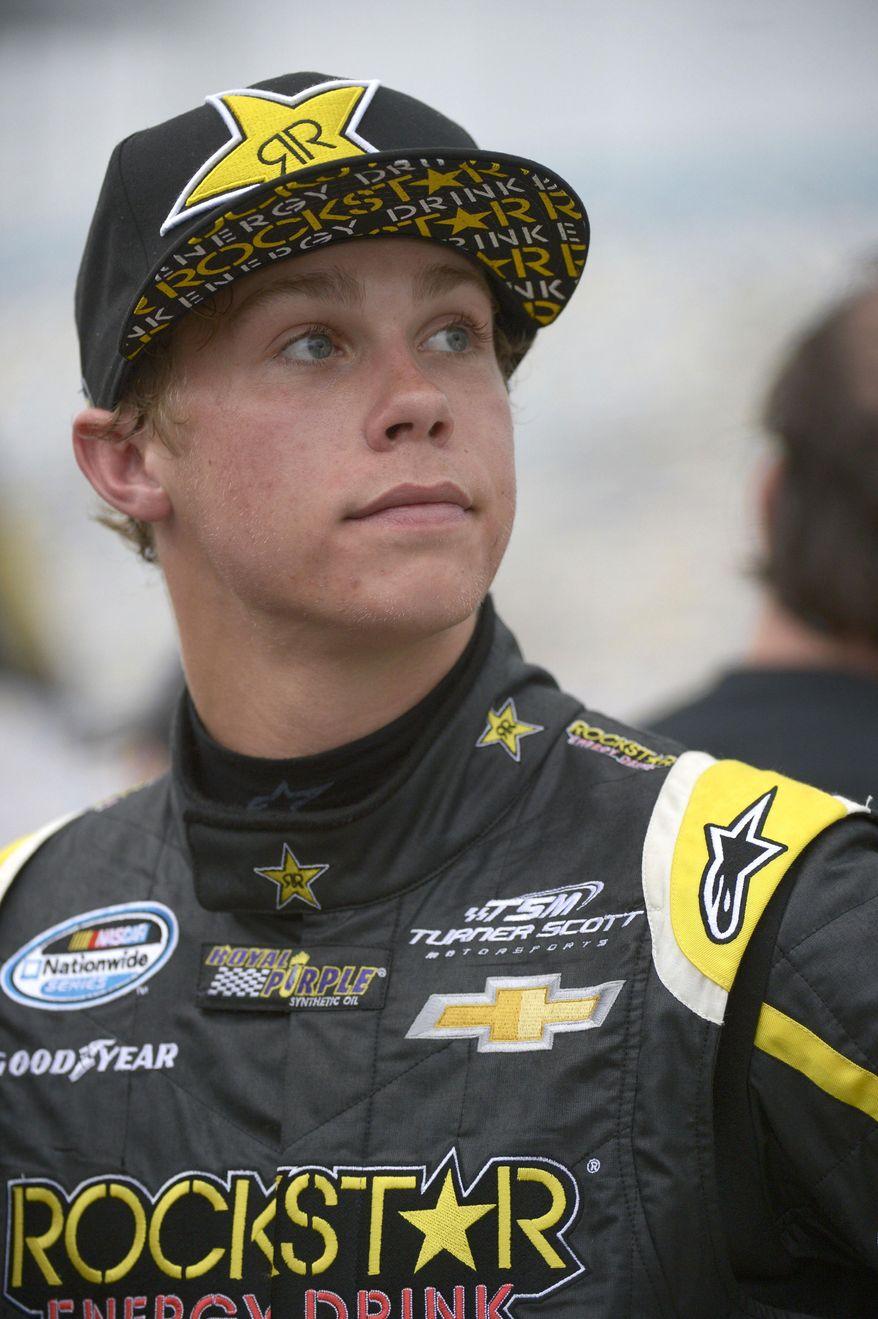 Dylan Kwasniewski looks up at the sky after qualifying for Saturday's NASCAR Nationwide Series auto race at Daytona International Speedway in Daytona Beach, Fla., Friday, Feb. 21, 2014. (AP Photo/Phelan M. Ebenhack)