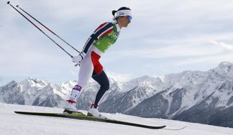 Norway's Marit Bjoergen skis during the women's classical-style cross-country team sprint competitions at the 2014 Winter Olympics, Wednesday, Feb. 19, 2014, in Krasnaya Polyana, Russia. (AP Photo/Dmitry Lovetsky)
