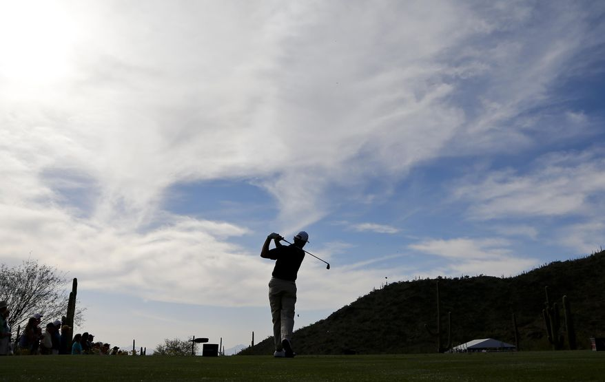 Ernie Els, of South Africa, watches his tee shot on the 18th hole in his match against Justin Rose, of England during the second round of the Match Play Championship golf tournament on Thursday, Feb. 20, 2014, in Marana, Ariz. (AP Photo/Matt York)