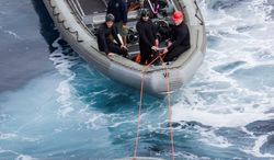 This Wednesday, Feb. 19, 2014 photo released by NASA shows crews testing a  test version of Orion's forward bay cover, NASA's next-generation space capsule. NASA and the Navy suspended the test Thursday, Feb. 20, 2014 off the coast of San Diego after a problem was discovered. (AP Photo/NASA)