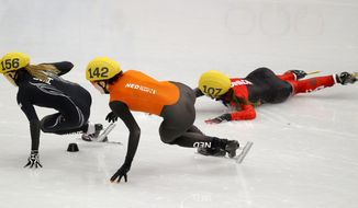 Valerie Maltais of Canada, right, crashes out as she competes with Jessica Smith of the United States, left, and Jorien ter Mors of the Netherlands, centre, in a women's 1000m short track speedskating semifinal at the Iceberg Skating Palace during the 2014 Winter Olympics, Friday, Feb. 21, 2014, in Sochi, Russia. (AP Photo/Vadim Ghirda)