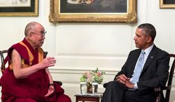 President Barack Obama meets with the Dalai Lama in the Map Room of the White House, Feb. 21, 2014. (Official White House Photo by Pete Souza)