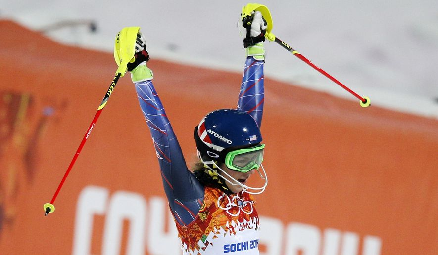 Gold medal winner Mikaela Shiffrin of the United States celebrates as she finishes the second run of the women's slalom at the Sochi 2014 Winter Olympics, Friday, Feb. 21, 2014, in Krasnaya Polyana, Russia.(AP Photo/Christophe Ena)