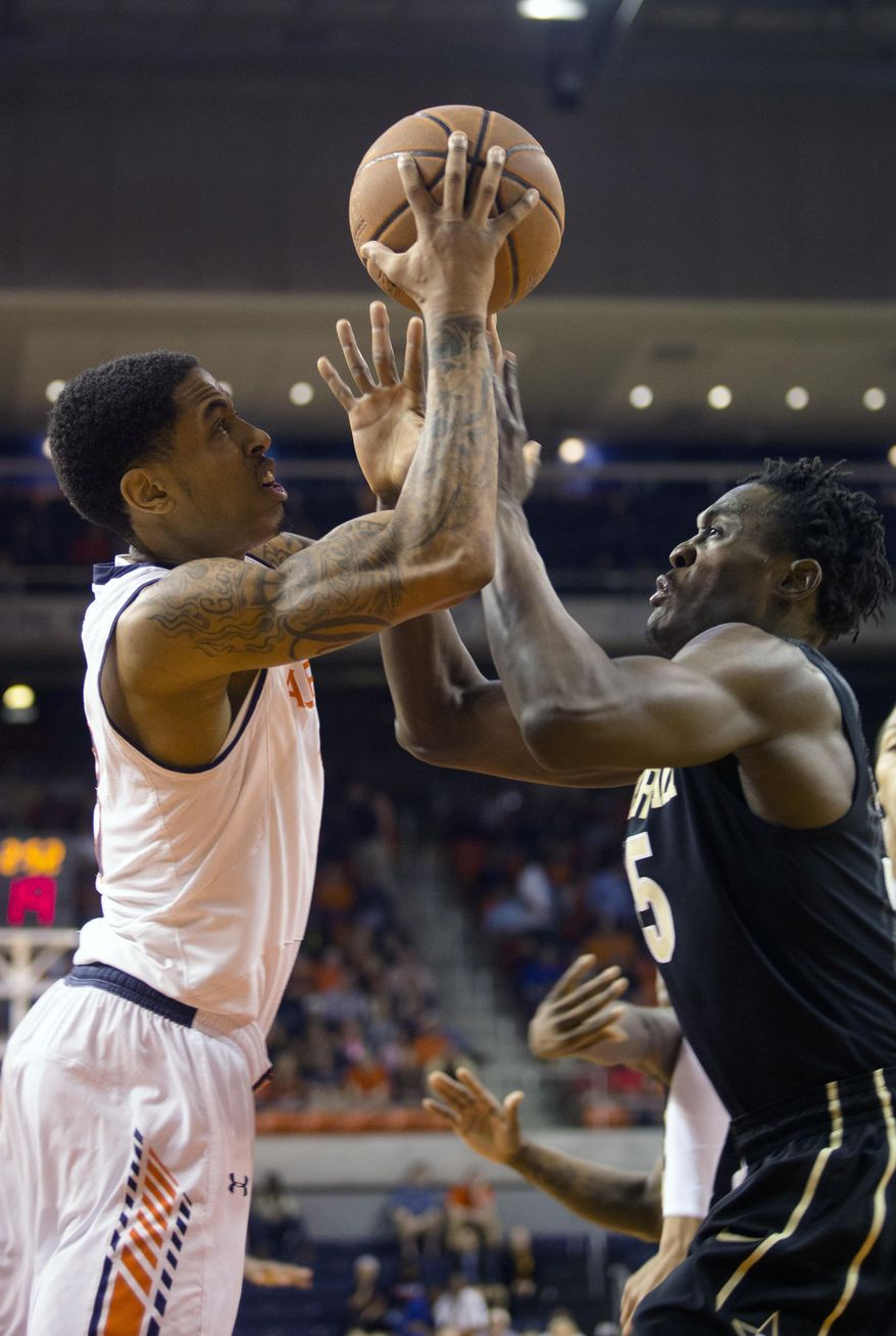 Auburn's Chris Denson, left, shoots as Vanderbilt's James Siakam, right, defends during an NCAA college basketball game, Saturday, Feb. 22, 2014, in Auburn, Ala. Vanderbilt won 67-59. (AP Photo/Opelika-Auburn News, Albert Cesare)
