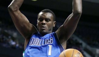 Dallas Mavericks center Samuel Dalembert dunks against the Detroit Pistons during the first half of an NBA basketball game Saturday, Feb. 22, 2014, in Auburn Hills, Mich. (AP Photo/Duane Burleson)