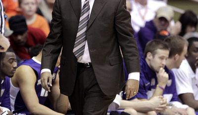 Washington coach Lorenzo Romar paces in front of the bench during the first half of an NCAA basketball game against Oregon State in Corvallis, Ore., Saturday, Feb. 22, 2014.(AP Photo/Don Ryan)