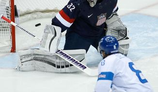 Teemu Selanne of Finland scores a goal on goalkeeper Jonathan Quick of the United States during the second period of the men's bronze medal ice hockey game at the 2014 Winter Olympics, Saturday, Feb. 22, 2014, in Sochi, Russia. (AP Photo/Matt Slocum)