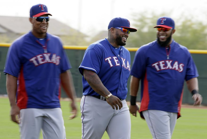 Texas Rangers' Adrian Beltre, from left, Prince Fielder and Elvis Andrus, right, laugh as they warm up for a morning workout during spring training baseball practice, Wednesday, Feb. 19, 2014, in Surprise, Ariz. (AP Photo/Tony Gutierrez)