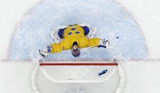 Sweden goaltender Henrik Lundqvist reacts after a men's semifinal ice hockey game against Finland at the 2014 Winter Olympics, Friday, Feb. 21, 2014, in Sochi, Russia. Sweden won 2-1 to advance to the gold medal game. (AP Photo/David J. Phillip_ )