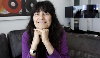 """Ruth Reichl, the former editor-in-chief of Gourmet magazine, poses for a photograph, Saturday, Feb. 22, 2014, in Miami Beach, Fla. After the shuttering of the magazine, Reichl needed to find her footing and has written her first novel """"Delicious!"""" will be published in May 2014. (AP Photo/Lynne Sladky)"""