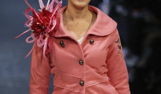 In this Nov. 20, 2004 photo, Charlotte Dawson models Trelise Cooper's fashion on the catwalk during the Air New Zealand Fashion Week in Auckland, New Zealand. Australian TV star and former model Dawson was found dead at age 47 in her Sydney apartment on Saturday morning, Feb. 22, 2014, following a history of depression. Police said there were no suspicious circumstances. (AP Photo/New Zealand Herald, Nicola Topping) NEW ZEALAND OUT, AUSTRALIA OUT, FAIRFAX OUT