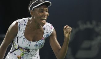 Venus Williams of the U.S. celebrates after she beats Alize Cornet of France during the final match of Dubai Duty Free Tennis Championships in Dubai, United Arab Emirates, Saturday, Feb. 22, 2014. (AP Photo/Kamran Jebreili)