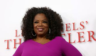 "FILE - In this Aug. 12, 2013 file photo, Oprah Winfrey arrives at the Los Angeles premiere of ""Lee Daniels' The Butler"" at the Regal Cinemas L.A. Live Stadium 14, in Los Angeles. Winfrey is paying tribute to the late Nelson Mandela at the NAACP Image Awards on Saturday, Feb. 22, 2014. ""12 Years a Slave,"" ""Lee Daniels' The Butler,"" ""Fruitvale Station,"" ''Mandela: Long Walk to Freedom"" and ""The Best Man Holiday"" are vying for the outstanding motion picture trophy. (Photo by Matt Sayles/Invision/AP, file)"