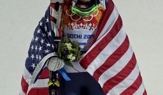Women's gold medalist, United States' Mikaela Shiffrin, reacts after dropping her ski pole during the flower ceremony for the women's slalom at the Sochi 2014 Winter Olympics, Friday, Feb. 21, 2014, in Krasnaya Polyana, Russia. (AP Photo/Charlie Riedel)