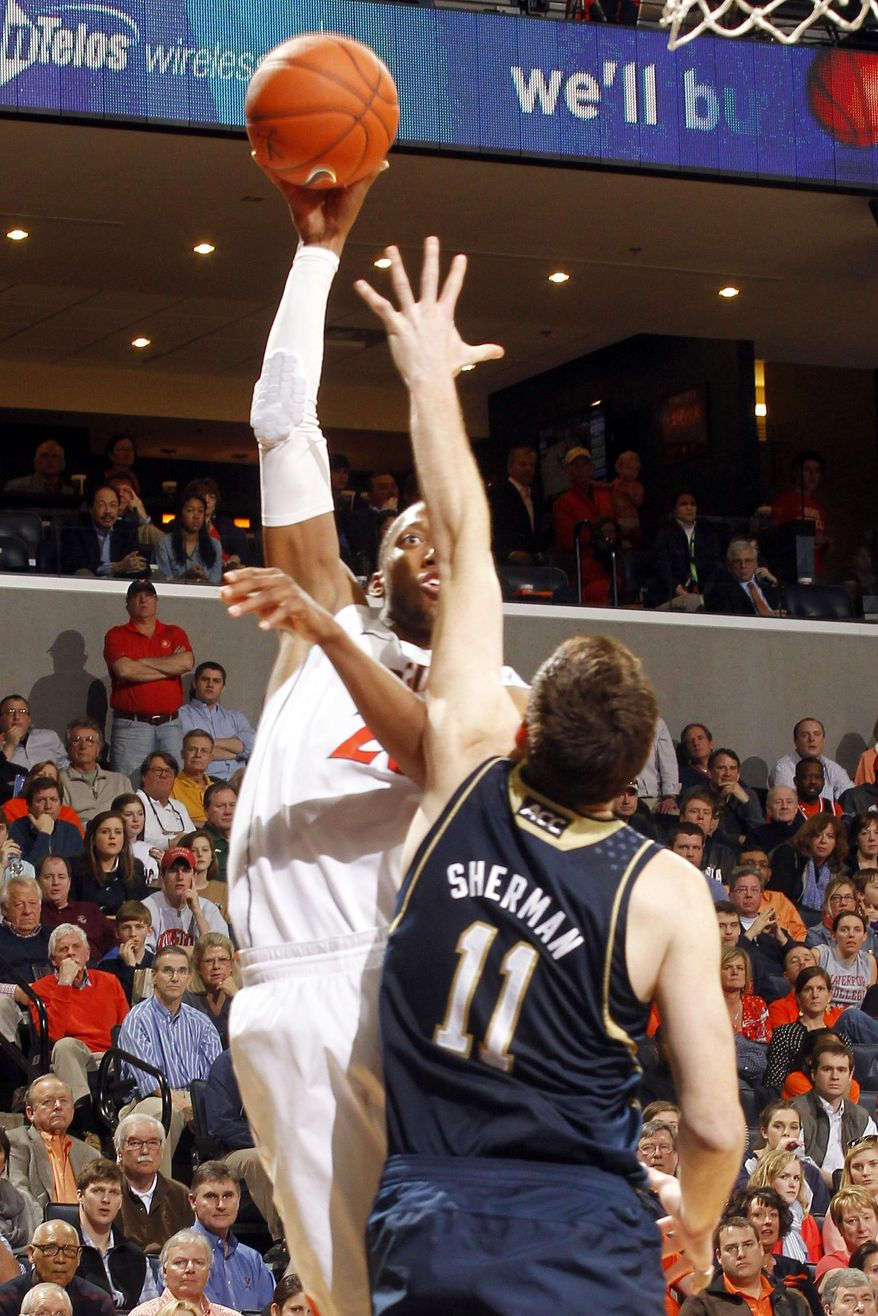 Virginia forward Akil Mitchell, left, shoots over Notre Dame center Garrick Sherman (11) during an NCAA college basketball game Saturday, Feb. 22, 2014, in Charlottesville, Va. Virginia won 70-49. (AP Photo/Andrew Shurtleff)