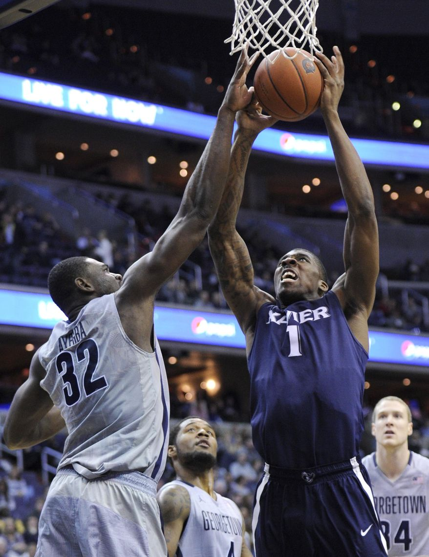 Xavier forward Jalen Reynolds (1) goes to the basket against Georgetown center Moses Ayegba (32) during the first half of an NCAA college basketball game, Saturday, Feb. 22, 2014, in Washington. (AP Photo/Nick Wass)