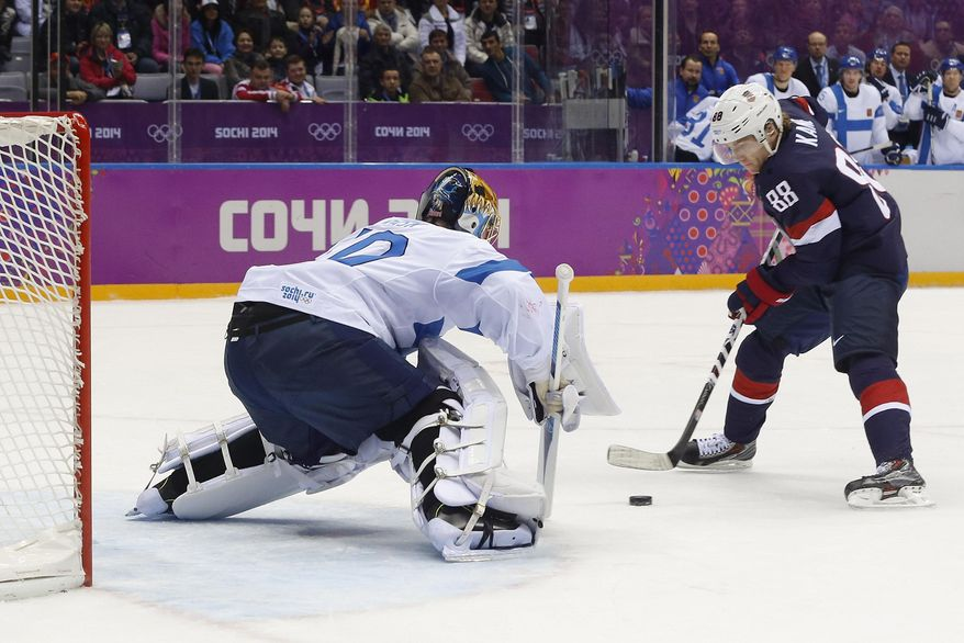 USA forward Patrick Kane takes a penalty shot against Finland goaltender Tuukka Rask during the first period of the men's bronze medal ice hockey game at the 2014 Winter Olympics, Saturday, Feb. 22, 2014, in Sochi, Russia.  Kane missed the shot. (AP Photo/Mark Humphrey)