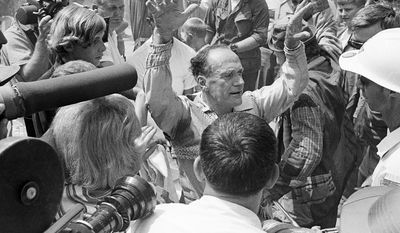 FILE - In this July 18, 1970 file photo, Karl Wallenda celebrates after completing the tightrope walk across the Tallulah Gorge in Tallulah Falls, Ga. In a Feb. 8, 2014 interview, his great-grandson, Nik Wallenda, said hopes to accomplish the same feat in the near future. (AP Photo/Bob Schutz)