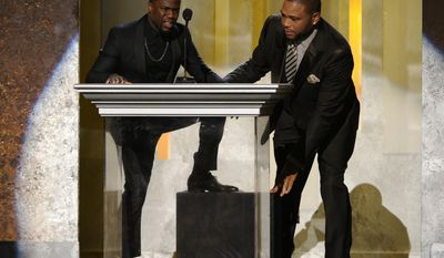Kevin Hart, left, and Anthony Anderson speak on stage at the 45th NAACP Image Awards at the Pasadena Civic Auditorium on Saturday, Feb. 22, 2014, in Pasadena, Calif. (Photo by Chris Pizzello/Invision/AP)