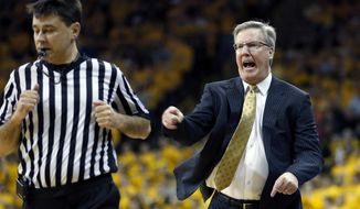 Iowa head coach Fran McCaffery yells at one of the officials after offensive foul call during the first half of an NCAA college basketball game in Iowa City, Iowa, Saturday, Feb. 22, 2014. (AP Photo/Justin Hayworth)