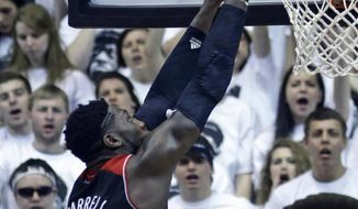 Louisville forward Montrezl Harrell (24) shoots against Cincinnati in the first half of an NCAA college basketball game, Saturday, Feb. 22, 2014, in Cincinnati. (AP Photo/Al Behrman)