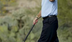 Ernie Els, of South Africa, removes his hat after his win on the 17th hole in his match against Jason Dufner during the third round of the Match Play Championship golf tournament on Friday, Feb. 21, 2014, in Marana, Ariz. (AP Photo/Ted S. Warren)