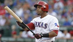 In this Aug. 1, 2013, photo, Texas Rangers' Nelson Cruz prepares for his at-bat during the second inning of a baseball game against the Arizona Diamondbacks in Arlington, Texas. A person familiar with the deal tells The Associated Press that Cruz, a free agent, and the Baltimore Orioles have reached agreement on a one-year contract. The person spoke Saturday, Feb. 22, 2014, on condition of anonymity because the contract was not complete. Cruz will earn about $8.5 million, and can make more in performance bonuses. Other media outlets had reported a deal was in place. (AP Photo/LM Otero)