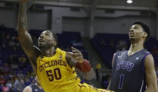 Iowa State guard DeAndre Kane (50) shoots past TCU center Karviar Shepherd (1) during the first half of an NCAA college basketball game Saturday, Feb. 22, 2014, in Fort Worth, Texas. (AP Photo/LM Otero)