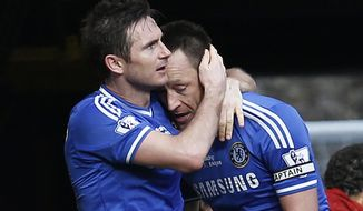 Chelsea's Frank Lampard, left, embraces his captain John Terry, after scoring against Everton during an English Premier League soccer match at the Stamford Bridge ground in London, Saturday, Feb. 22, 2014. Chelsea won the match 1-0. (AP Photo/Lefteris Pitarakis)