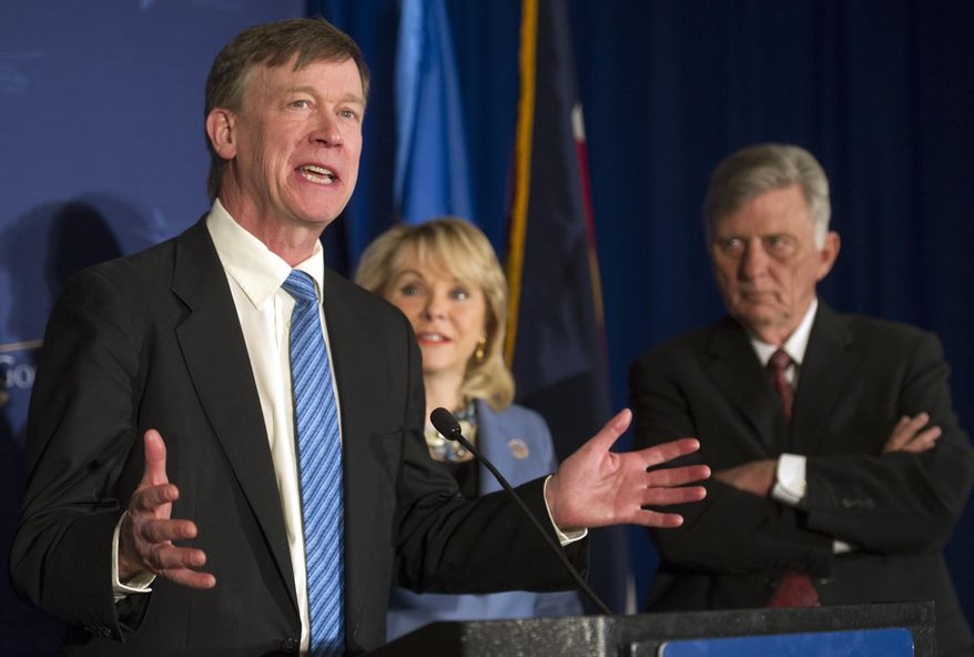 Colorado Gov. John Hickenlooper, left, speaks to the news media as Arkansas Gov. Mike Beebe, right, and National Governor's Association chair Oklahoma Gov. Mary Fallin, center, listen during the NGA's Winter Meeting in Washington, Saturday, Feb. 22, 2014. (AP Photo/Cliff Owen)