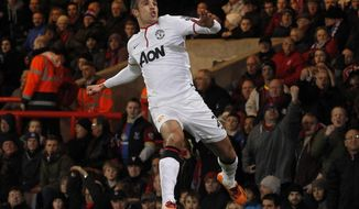 Manchester United's Robin Van Persie celebrates his penalty goal against Crystal Palace during their English Premier League soccer match at Selhurst Park, London, Saturday, Feb. 22, 2014. (AP Photo/Sang Tan)