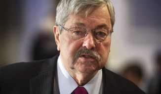 Iowa Gov. Terry Branstad participates in the morning session of the National Governor's Association Winter Meeting in Washington, Saturday, Feb. 22, 2014. (AP Photo/Cliff Owen)