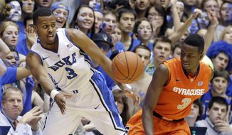 Duke's Tyler Thornton (3) saves the ball from out of bounds as Syracuse's Jerami Grant (3) stands near during the second half of an NCAA college basketball game in Durham, N.C., Saturday, Feb. 22, 2014. Duke won 66-60. (AP Photo/Gerry Broome)