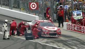 Crew members work to repair Kyle Larson's car during the NASCAR Daytona 500 Sprint Cup series auto race at Daytona International Speedway, Sunday, Feb. 23, 2014, in Daytona Beach, Fla.. (AP Photo/David Graham)