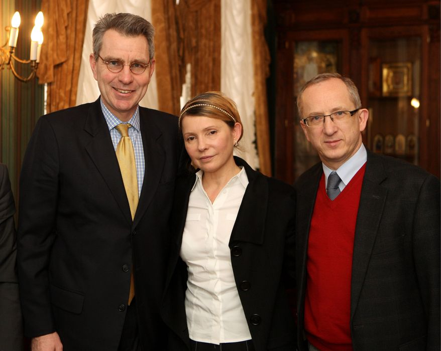 Ukrainian opposition figure Yulia Tymoshenko meets in Kiev on Sunday with U.S. Ambassador Geoffrey R. Pyatt (left) and EU Ambassador to Ukraine Jan Tombinski. An ally of Ms. Tymoshenko, who was recently released from prison, took presidential powers before elections can be held.
