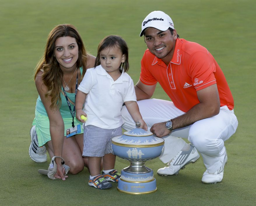 Jason Day, of Australia, right, his wife, Ellie, and son Dash, pose with the trophy after winning his championship match against Victor Dubuisson, of France, during the Match Play Championship golf tournament on Sunday, Feb. 23, 2014, in Marana, Ariz. (AP Photo/Ted S. Warren)