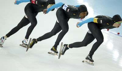 The U.S. speedskating team, left to right, Brian Hansen, Shani Davis and Jonathan Kuck compete in the men's speedskating team pursuit quarterfinals at the Adler Arena Skating Center during the 2014 Winter Olympics in Sochi, Russia, Friday, Feb. 21, 2014.  (AP Photo/Pavel Golovkin)
