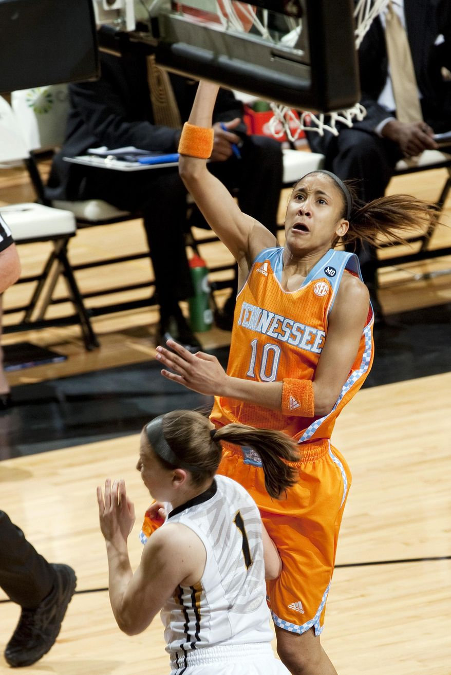 Tennessee's Meighan Simmons, top, shoots over Missouri's Lianna Doty during the first half of an NCAA college basketball game Sunday, Feb. 23, 2014, in Columbia, Mo. (AP Photo/L.G. Patterson)