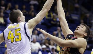 California's David Kravish (45) blocks the shot of Southern California's Nikola Jovanovic, right, in the second half of an NCAA college basketball game, Sunday, Feb. 23, 2014, in Berkeley, Calif. (AP Photo/Ben Margot)