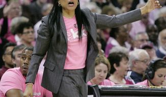 South Carolina's Dawn Staley talks to her players during the second half of their NCAA college basketball game against Florida, Sunday Feb. 23, 2014, in Columbia, SC. South Carolina defeated Florida 69-55. (AP Photo/Mary Ann Chastain)