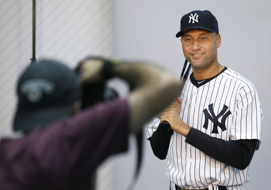 New York Yankees shortstop Derek Jeter poses for a photographer during the Yankees' photo day before a spring training baseball practice Saturday, Feb. 22, 2014, in Tampa, Fla. (AP Photo/Charlie Neibergall)