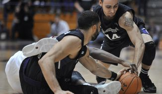 Northwestern's Tre Demps (14), and Drew Crawford battle Indiana's Stanford Robinson for the ball during the second half of an NCAAcollege  basketball game in Evanston, Ill., Saturday, Feb. 22, 2014. Indiana won 61-56. (AP Photo/Paul Beaty)