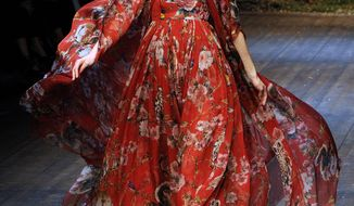 A model wears a creation for Dolce & Gabbana women's Fall-Winter 2014-15 collection, part of the Milan Fashion Week, unveiled in Milan, Italy, Sunday, Feb. 22, 2014. (AP Photo/Giuseppe Aresu)
