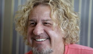 """In this Saturday, Feb. 22, 2014 photo, In this Saturday, Feb. 22, 2014 photo, musician Sammy Hagar smiles during an interview in Miami. Hagar, known as the """"Red Rocker"""" and lead singer of the band Van Halen, sold his part of the Cabo Wabo Tequila company not long ago and turned his attention to rum. Sammy's Beach Bar Rum is made in Hawaii, where Hagar has a home. (AP Photo/Lynne Sladky)"""
