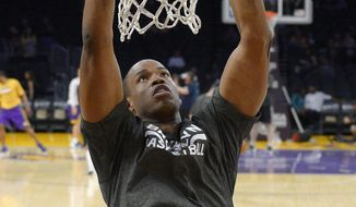 Brooklyn Nets center Jason Collins warms up prior to an NBA basketball game against the Los Angeles Lakers, Sunday, Feb. 23, 2014, in Los Angeles. Collins is set to become the NBA's first active openly gay player. He signed a 10-day contract with the Brooklyn Nets earlier Sunday and was to be in uniform for their game in Los Angeles against the Lakers. The 35-year-old center revealed at the end of last season he is gay, but he was a free agent and had remained unsigned. (AP Photo/Mark J. Terrill)