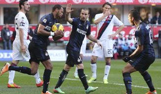 Inter Milan defender Jorge Rolando, second from left, of Portugal, holds the ball after scoring during the Serie A soccer match between Inter Milan and Cagliari at the San Siro stadium in Milan, Italy, Sunday, Feb. 23, 2014. (AP Photo/Antonio Calanni)