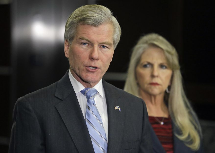 FILE -  In this Tuesday, Jan. 21, 2014 file photo, former Virginia Gov. Bob McDonnell makes a statement as his wife, Maureen, listens during a news conference in Richmond, Va. The former first lady of Virginia and her husband, former Gov. Bob McConnell, have been indicted on several counts of trading on their influence to enrich themselves and family members. (AP Photo/Steve Helber, File)